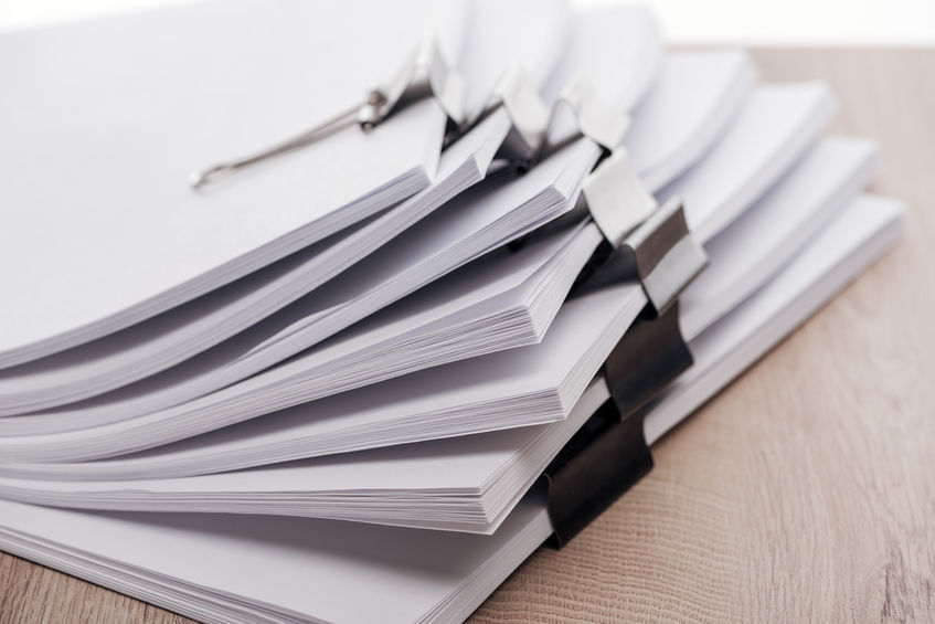 close up view of stacks of blank paper
